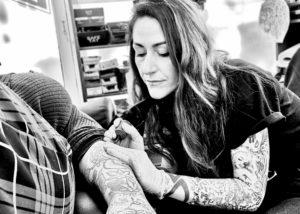 La mort custom tattoo leicester background image